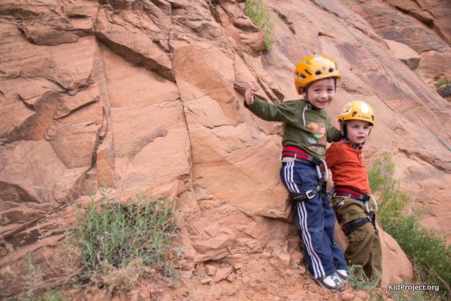 two boys climbing