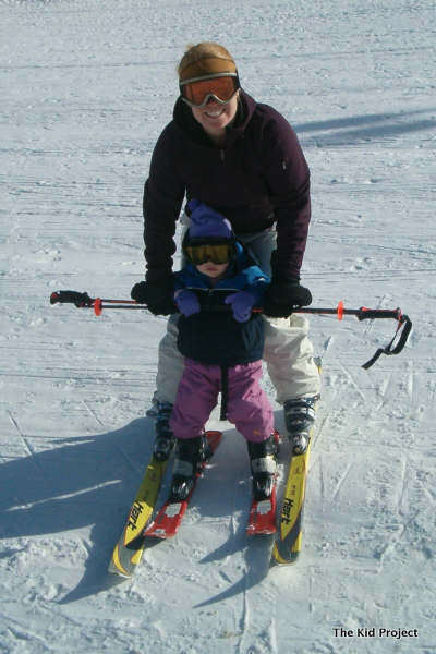 Teaching toddlers to ski- between the legs