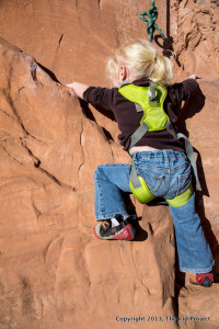 2 year old girl climbing near moab