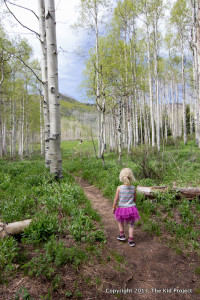 girl tutu hiking through aspens