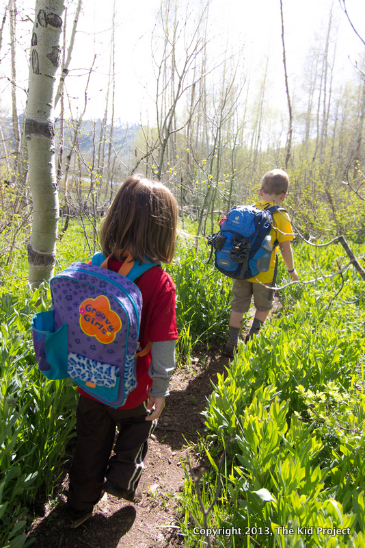Kids hiking with backpacks