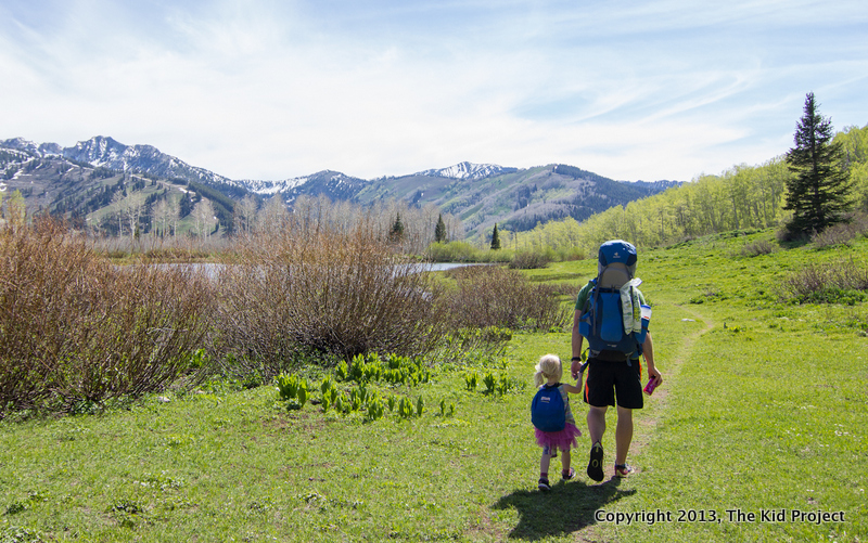 Family backpacking in meadow