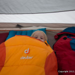 Girl in Deuter Sleeping Bag, in tent