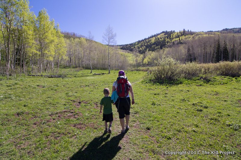 Mom and son hiking edge of lake