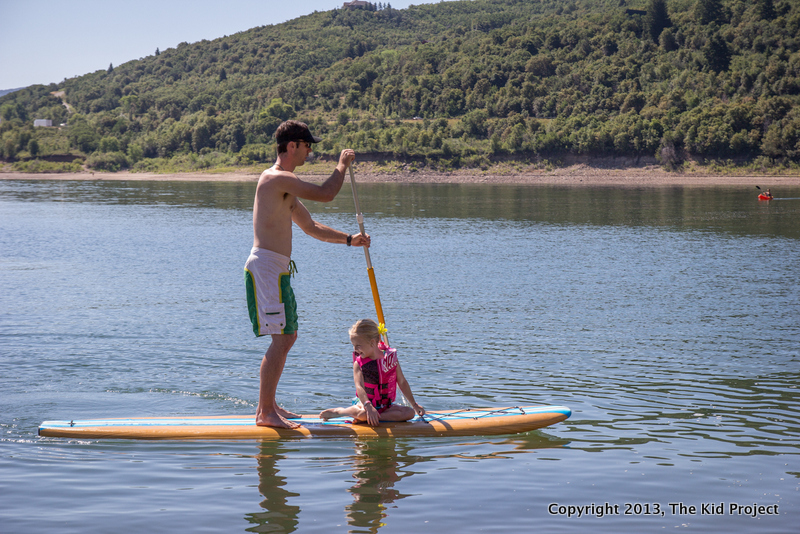 girl and dad on paddle board