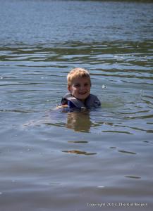 boy in lifejacket swimming