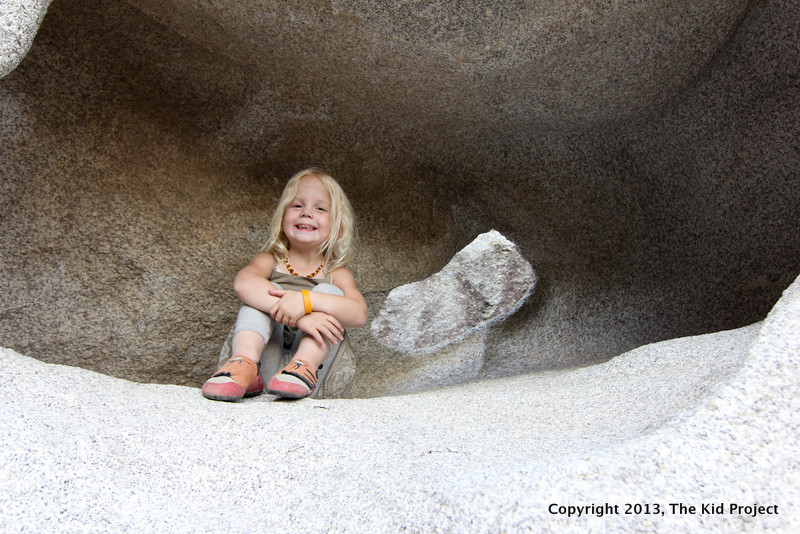 Girl in rock cave