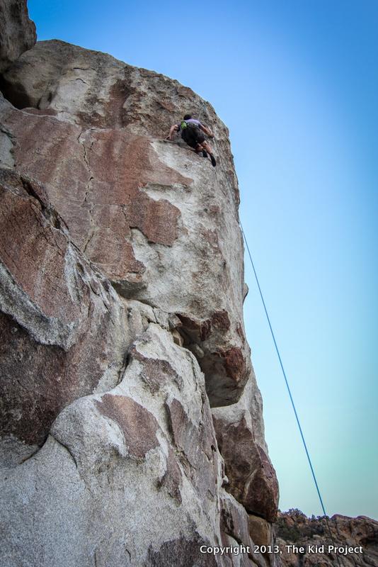 Guy climbing at dusk, City of Rocks