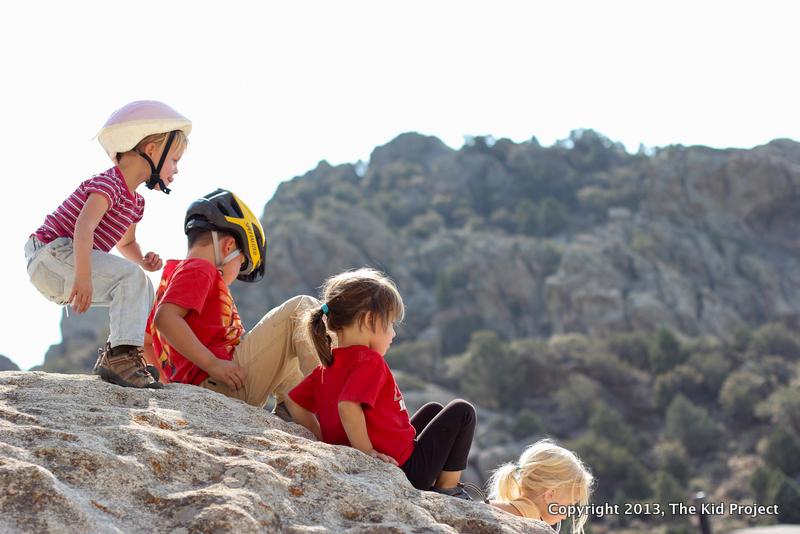 Kids scrambling on rocks
