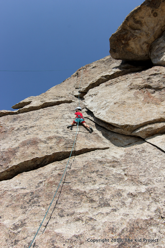 Seven year old girl climbing