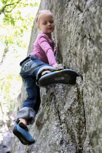 Girl bouldering in Utah