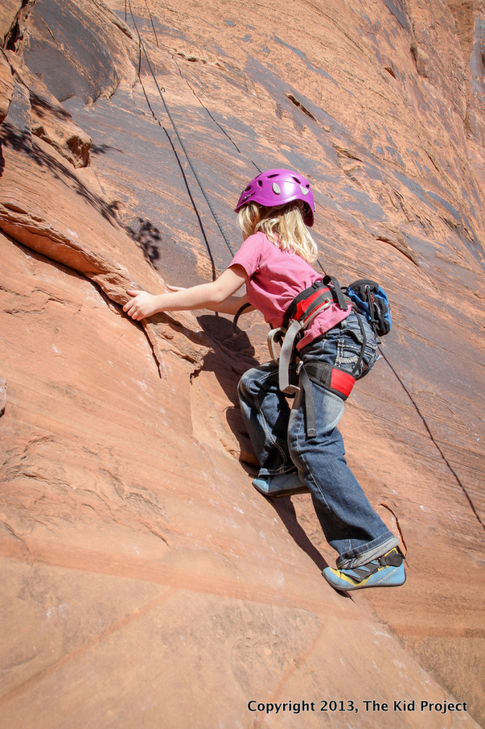 girl climbing Seibernetics, Potash Road, Moab