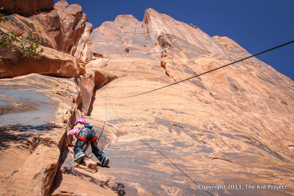girl climbing on Potash Road, Southern Utah