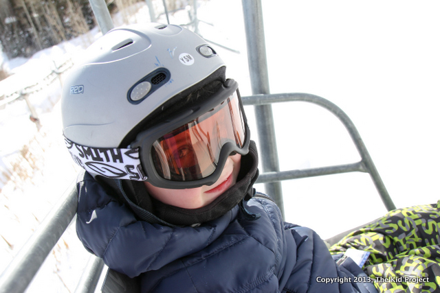 Happy boy on the ski lift