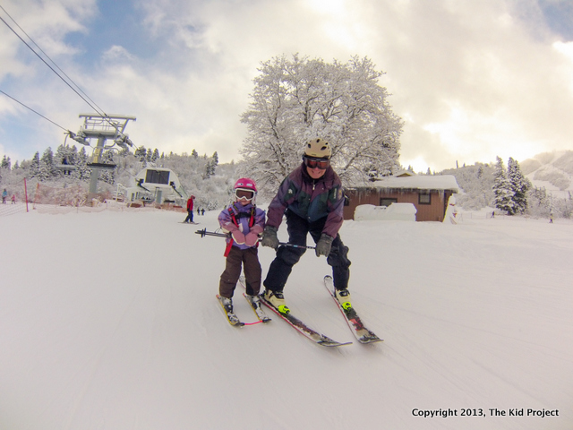 grandpa and toddler skiing at Snowbasin
