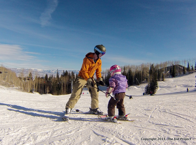 Dad skiing with toddler at Canyons Resort, Utah