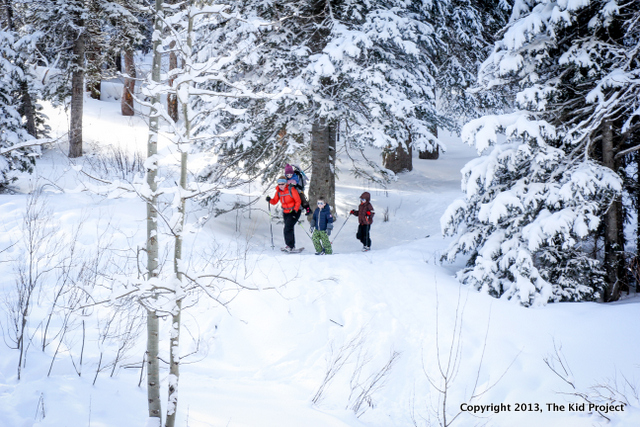 being an outdoor mom, snowshoeing through forest