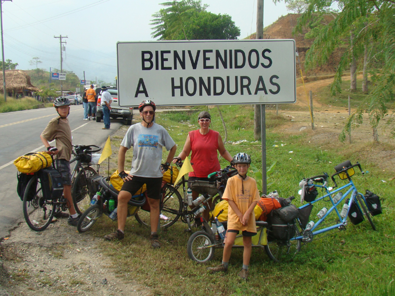 welcome to honduras, family on bikes