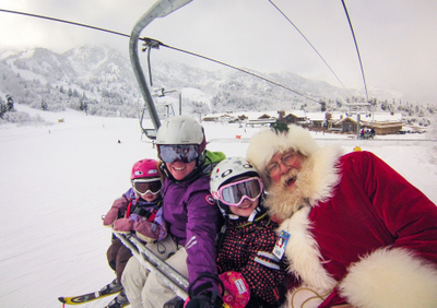 santa on a ski lift