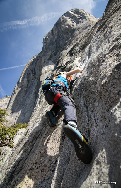 "7-yr-old climbing ""Pine Line"" with El Cap above her"