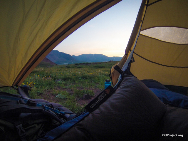 Peering out out tent while backpacking