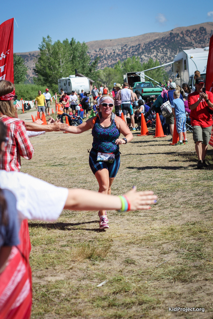 racing to the finish line, running at Echo Tri