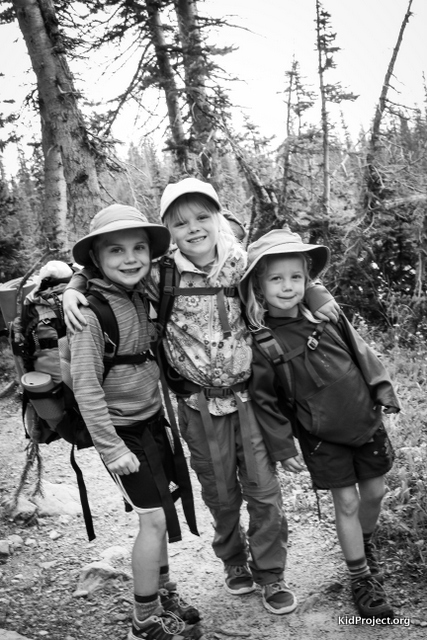 Three siblings backpacking in the high Uintas,