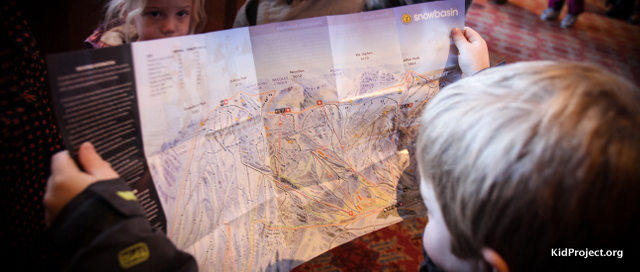kid looking at ski area map