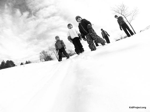 Family time sledding in Salt Lake City, UT