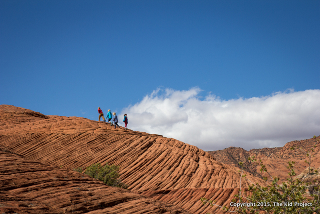 Hiking on the slick rock and scrambling around.