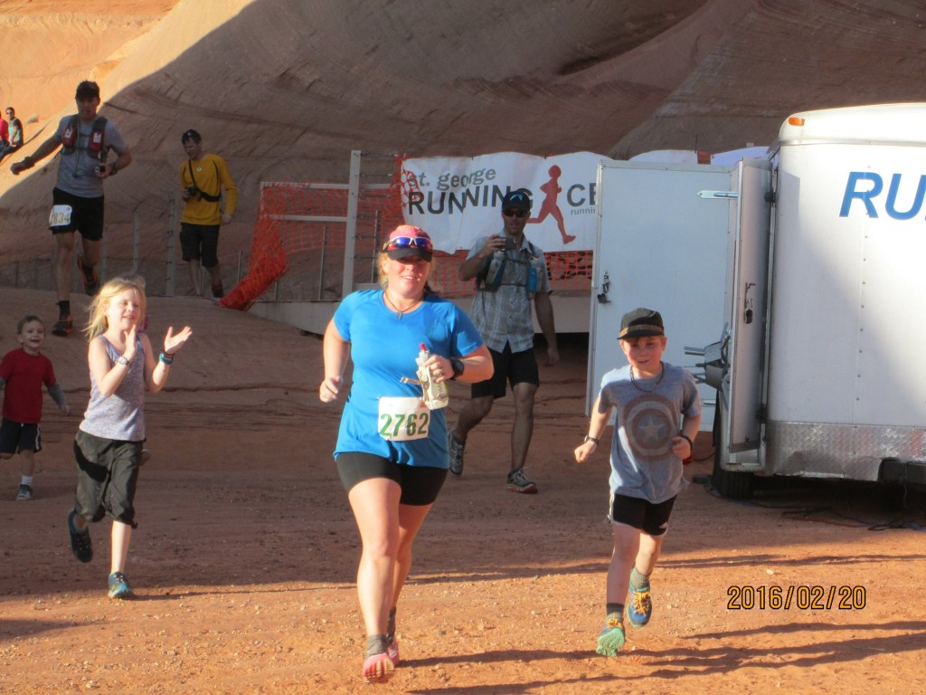 Running through the finish with my kids. Photo Credit: Gene Raymond