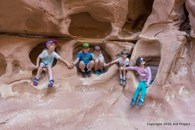 kids hiking in sandstone