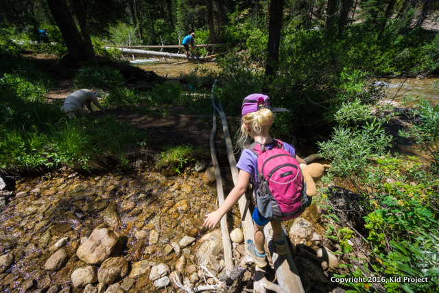 kid hiking and water crossing