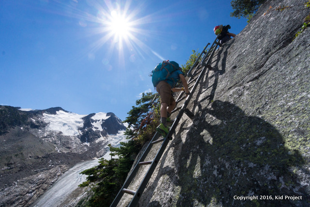 climbing ladder on Bugaboo hike