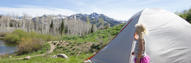 little girl backpacking with Kelty tent