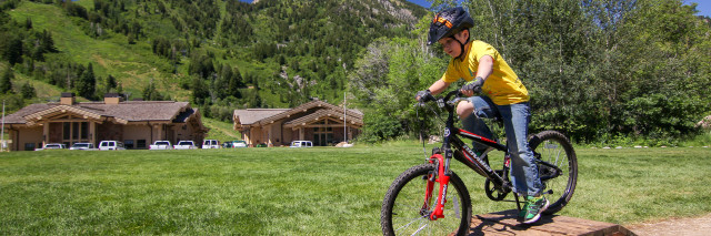 kid mountain biking on skills park, Snowbasin